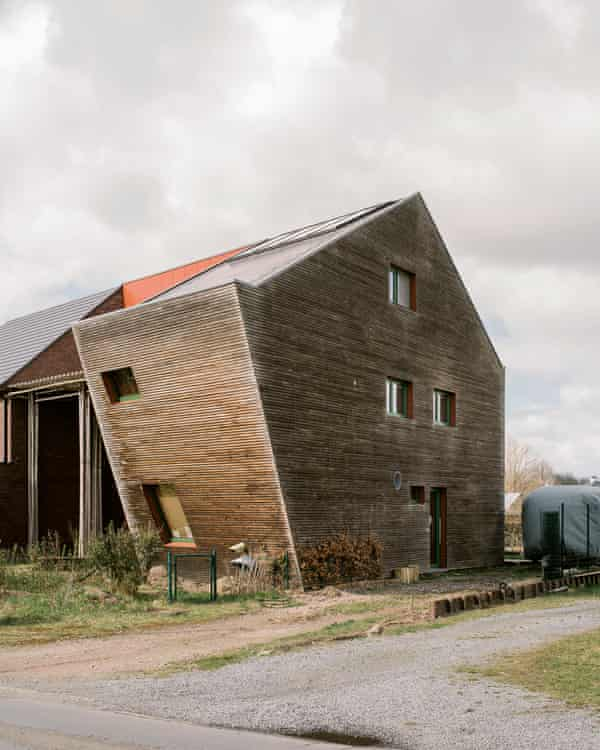 A passive house, with slanted walls that create shadow and prevent the sun from shining straight into the house