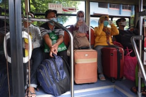 Covid-19 patients at the Lubang Buaya Community Health Center, East Jakarta, Indonesia, wait in a pickup bus to be evacuated to the Wisma Atlet Emergency Hospital, Kemayoran, Jakarta, Friday 8 June 2021.