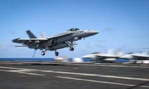 This handout picture released by the US navy shows an F/A-18E Super Hornet landing on the flight deck of the carrier USS Abraham Lincoln in the Gulf.