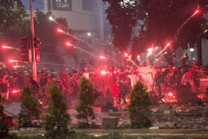 Jakarta, Indonesia. Protesters launch fireworks during a clash outside the election supervisory board building. Police have arrested 257 rioters involved in violent election demos