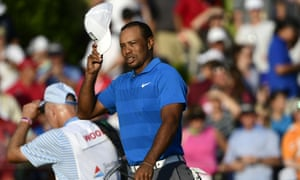 Tiger Woods salutes the crowd after holing out for par at the 18th and a three-shot lead at the end of round three of the Tour Championship.