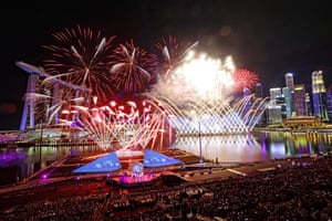 People watch a futuristic fireworks show at Star Island in Singapore's Marina Bay.