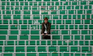 A Celtic fan in the area of rail seating at Celtic Park
