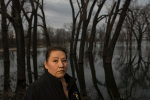 "Shelly Saunsoci, who is both the vice-chair of the community and the tribal employment rights director, in Swan Lake, SD. ""We feel like we are all alone,"" says Saunsoci. She has been organizing flood relief with no help from FEMA, the federal or state government."