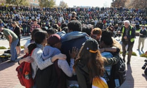 Students embrace one another during a forum on the campus of University of Missouri.
