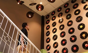 Records on the wall by the cafe's staircase. Dylan's cafe, Shillong, India.