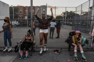 A woman poses for a portrait before participating in a pop-up roller skating session hosted by the Butter Roll skating club in Brooklyn.