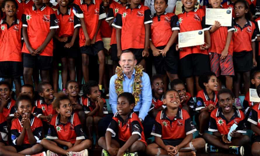 Tony Abbott with school children on Mer Island in the Torres Strait in 2015.