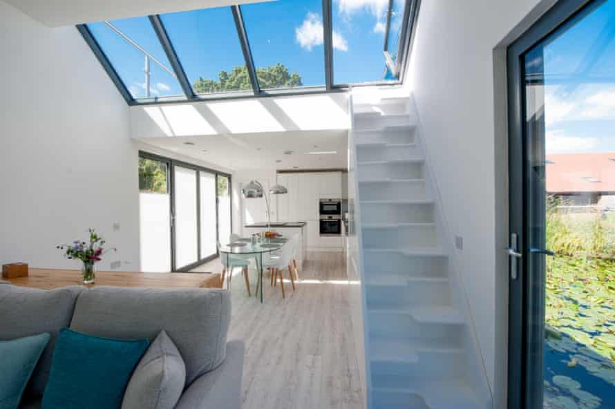 """The living area of """"The Chichester"""" showing the roof terrace stairs."""