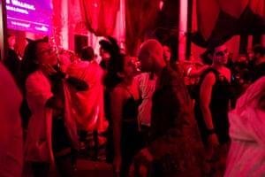 Sandra and Juan Carlos close to kissing at a Halloween party