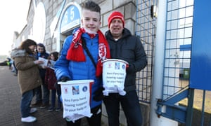 Middlesbrough supporters with collection buckets show their solidarity with the neighbouring club where Brian Clough cut his managerial teeth.