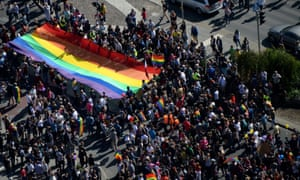 Marchers carry a huge rainbow-coloured flag during the parade in Warsaw, Poland.