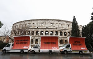 Rome, Italy. Three billboards outside the Colosseum address Silvio Berlusconi, the former prime minister, on the morning after election day. The display has been organised by the global civic movement Avaaz in response to the rightwing coalition not reaching a majority