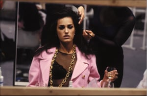 Backstage at Chanel in 1991, Yasmin Le Bon drinks wine while having her hair styled