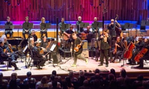 Nigel Kennedy, centre, and gadulka maestro Georgi Andreev, right, with Kennedy's band and the 'faintly bemused' Philharmonia Orchestra at the Barbican.