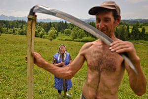 Traditional haymaking in Poland, where many people continue to use the scythe and pitchfork to sort the hay