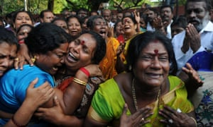 Supporters of Jayalalithaa Jayaram react outside the hospital to the first report of her death.