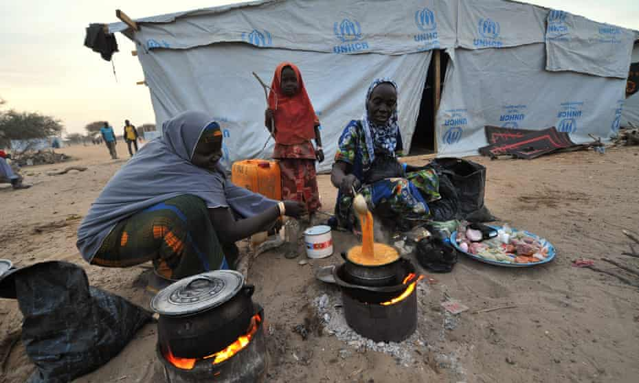 Nigerian women cook in a refugee camp in Baga Sola by Lake Chad.