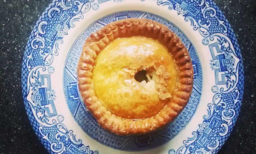 Directly above shot of pork pie served on plate.