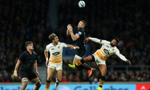 Mike Brown was tackled in the air by Josh Bassett at Twickenham.