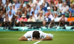 Roger Federer lies face down on the floor after of a slip during his semi-final defeat.