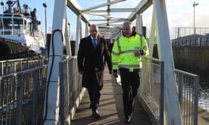 Home secretary Sajid Javid with a Border Force member at Dover.