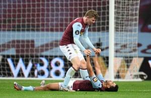 Aston Villa's Trezeguet and Matt Targett celebrate after the match.