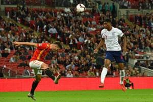Marcus Rashford has this header saved by Spain's goalkeeper David De Gea.