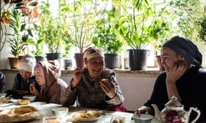 Buunisa Termechikova eats pilaf with her daughter and other guests at home in Burgan-Suu village.