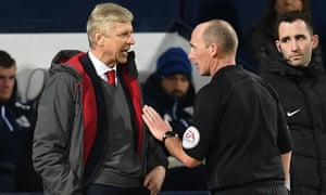 Arsène Wenger argues with Mike Dean after the referee handed a late penalty against Arsenal in their 1-1 draw with West Bromwich Albion on Sunday