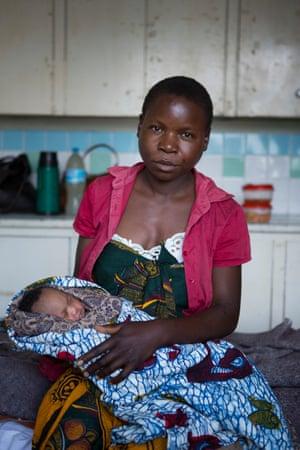 Zaituni Mohammed, 29, and her baby, Mariam, in the post-natal ward at Kiomboi Hospital in Iramba, Tanzania