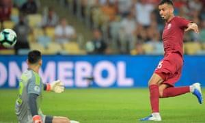 Boualem Khoukhi beats goalkeeper Roberto Fernandez to equalise for Qatar