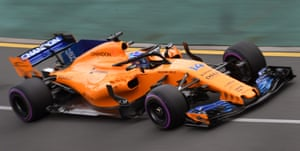 Fernando Alonso qualifies in his new orange McLaren, complete with halo safety device.