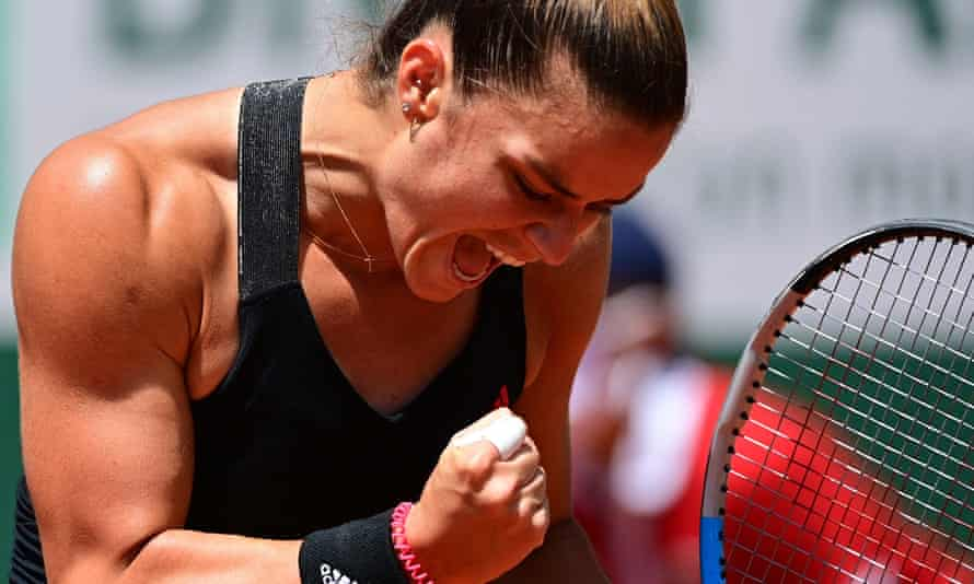 Maria Sakkari celebrates against the defending French Open champion Iga Swiatek