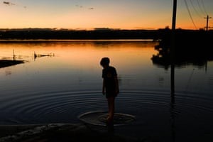 McGraths Hill, AustraliaA boy stands on the edge of the floodwaters in a suburb of Sydney, after widespread flooding
