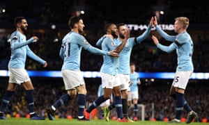 Manchester City's Raheem Sterling (centre) celebrates scoring his side's sixth goal.