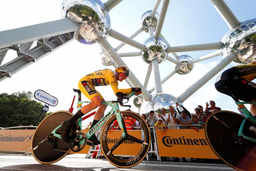 Team Jumbo-Visma rider Mike Teunissen of the Netherlands, wearing the overall leader's yellow jersey, passes the Atomium during the 27.6-km Stage 2 Team Time Trial from Brussels Royal Palace to Brussels Atomium.