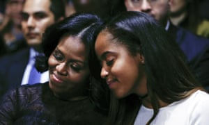 Michelle and Malia Obama react to the outgoing president's tribute.