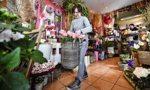 A florist prepares her shop in Gelsenkirchen, western Germany.