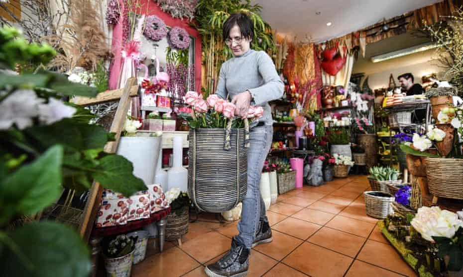 A florist prepares her shop in Gelsenkirchen, western Germany.