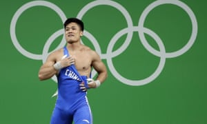 Lyu Xiaojun, of China, celebrates prematurely during the men's 77kg weightlifting competition.