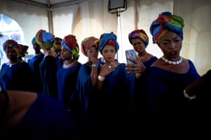 Bamako, MaliTwo Gold diggers take selfie pictures with their mobile phone while waiting in the backstage for the start of the fashion show as part of the first edition of the International Gold Fair. The Princess of Burundi, selected 34 women among gold mines workers in southern Mali, to walk down the catwalk for a fashion show organised during the International Gold Fair. Gold represents 15% of Mali's exports and more than 20% of its GDP estimated at nearly US$20 billion by the end of 2019