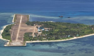A military handout photo of Thitu island in 2015. Locally known as Pag-asa, meaning 'hope' in Filipino, Thitu is a tree-studded settlement no more than a mile long and less than half a mile wide. A dilapidated runway takes up almost half the area.