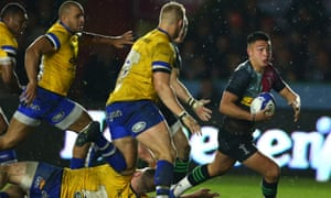 Marcus Smith launches an attack during Harlequins' home victory.
