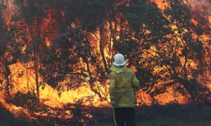 A firefighter works to contain a bushfire in Angourie, New South Wales