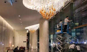 Workers put the finishing touches to decor at the Marriott hotel in Hanoi where Donald Trump will stay during his visit to Vietnam.