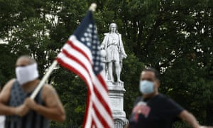 People gather near the statue of Christopher Columbus in South Philadelphia on 15 June 2020.