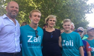 Zali Steggall with her husband Tim Irving and sons Rex Cameron (L) and Rent Cameron (R) on Sunday. Steggall is one of three female candidates standing against Tony Abbott in Warringah.