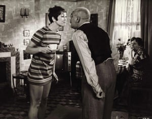 With Warren Mitchell in the sitcom Till Death Us Do Part, 1969.