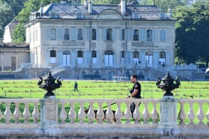A Swiss police dog unit patrols in front of Villa La Grange in Geneva, ahead of the summit